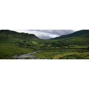 com Stream Through Lush Mountain Landscape, Distant Cottages, Ireland
