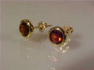 This is a nice pair of 14K gold and garnet earrings. Each stone