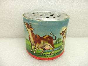 VINTAGE POCKET NOISE MAKER MOOING COW FARM CHILDS TOY